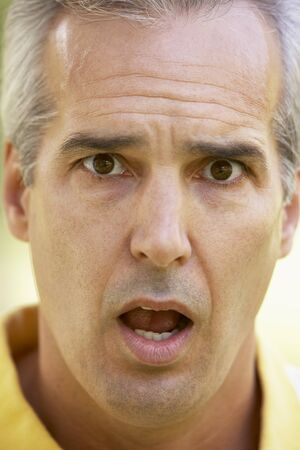 Portrait Of Surprised Middle Aged Man photo