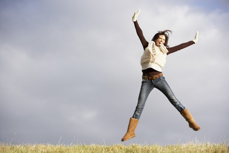winter escape: Young Woman Jumping In Air