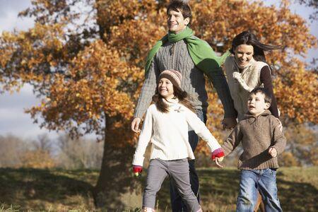 Family Walking In Park photo