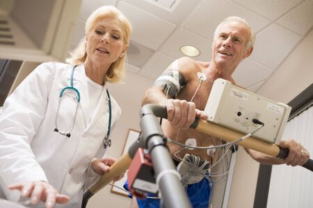 Doctor With Patient While They Run Being Monitored Stock Photo - 4606841