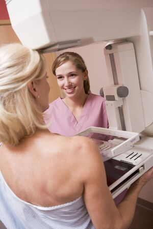 Nurse Assisting Patient Undergoing Mammogram Stock Photo - 4606446