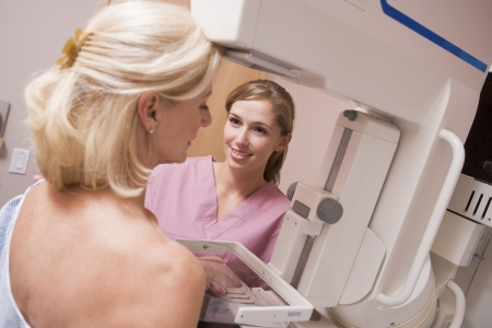 Nurse Assisting Patient Undergoing Mammogram photo