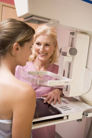 Nurse Assisting Patient Undergoing Mammogram Stock Photo - 4606992
