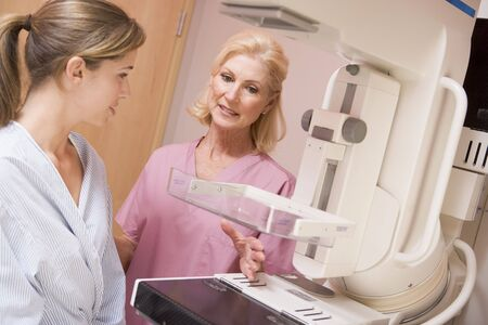 mammography: Nurse With Patient About To Have A Mammogram Stock Photo