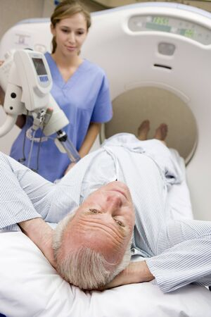 axial: Nurse With Patient As They Prepare For A Computerized Axial Tomography (CAT) Scan Stock Photo
