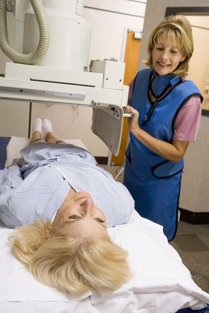 Nurse With Patient Having An X-Ray photo