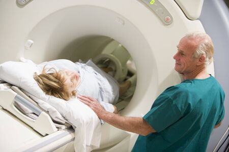 computed: Doctor With Patient As They Prepare For A Computerized Axial Tomography (CAT) Scan Stock Photo