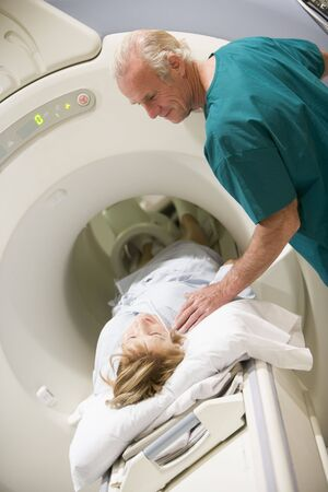 Doctor With Patient As They Prepare For A Computerized Axial Tomography (CAT) Scan photo