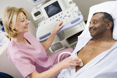 hospital gown: Nurse Giving Patient An Ultra Sound