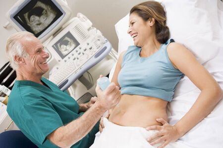 ultra: Doctor Giving Patient An Ultra Sound