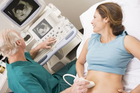 Doctor Giving Patient An Ultra Sound  photo