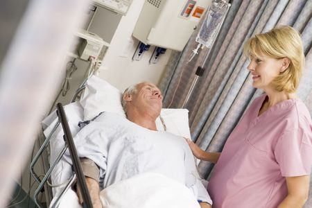 caring for: Nurse Caring For Patient Stock Photo