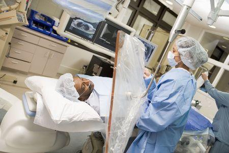 Surgeon Operating On Patient  photo