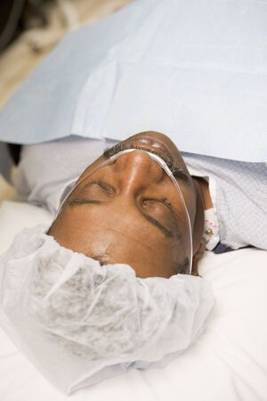Patient Under Anaesthetic In Operating Theatre  photo