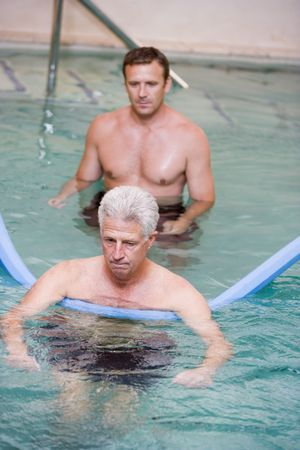 physical therapy: Instructor And Patient Undergoing Water Therapy