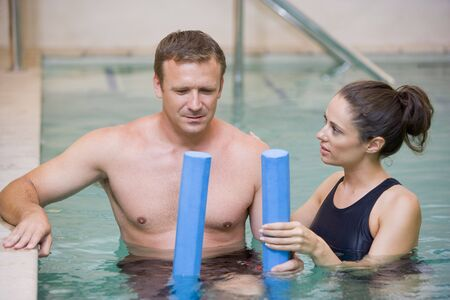 hydrotherapy: Instructor And Patient Undergoing Water Therapy