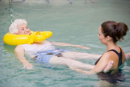 flotation: Instructor And Elderly Patient Undergoing Water Therapy