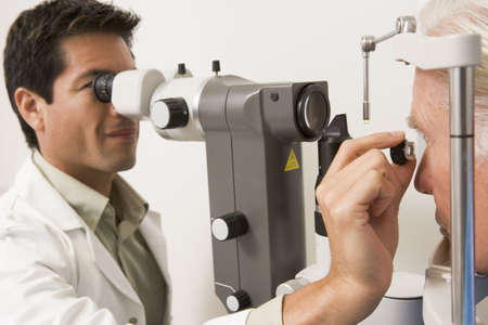 Doctor Checking Patients Eyes photo