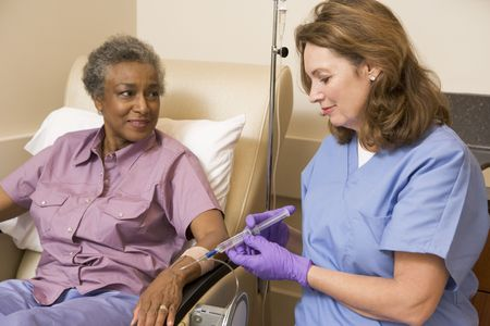 oncology: Nurse Giving Patient Injection Stock Photo