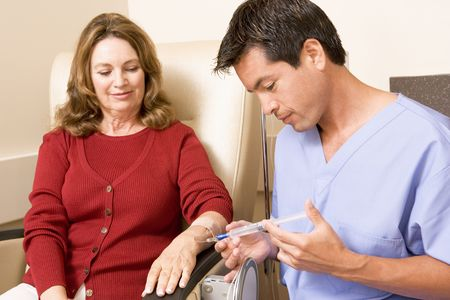 oncology: Nurse Giving Patient An Injection