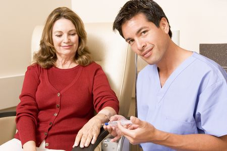 chemotherapy: Nurse Giving Patient An Injection