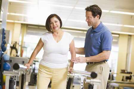 medical therapy: Physiotherapist With Patient In Rehabilitation