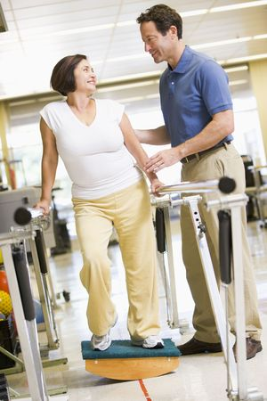physiotherapist: Physiotherapist With Patient In Rehabilitation