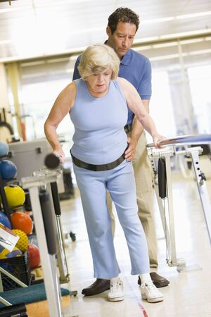 Physiotherapist With Patient In Rehabilitation Stock Photo - 4607157
