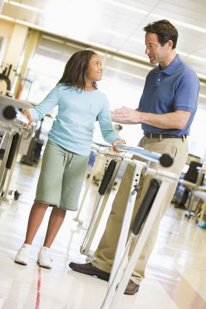 physical therapy: Physiotherapist With Patient In Rehabilitation