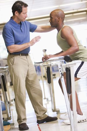 physical training: Physiotherapist With Patient In Rehabilitation