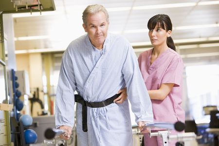 physical therapy: Nurse With Patient In Rehabilitation
