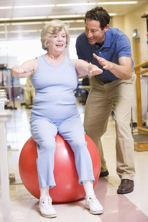 fourties: Physiotherapist With Patient In Rehabilitation