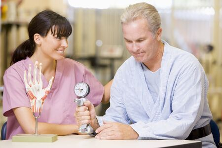 Nurse With Patient In Rehabilitation Stock Photo - 4607244