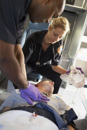 Paramedics performing CPR on patient in ambulance Stock Photo - 4607615
