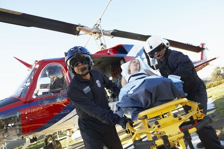 Paramedics unloading patient from Medevac photo