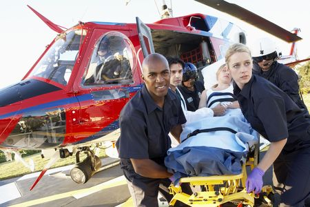 emergency services: Paramedics unloading patient from Medevac
