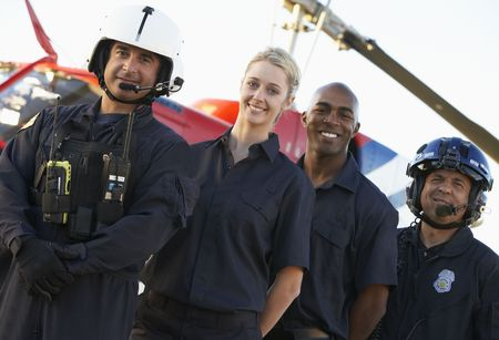 Portrait of paramedics standing in front of Medevac photo