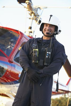 helicopter pilot: Portrait of paramedic standing in front of Medevac Stock Photo