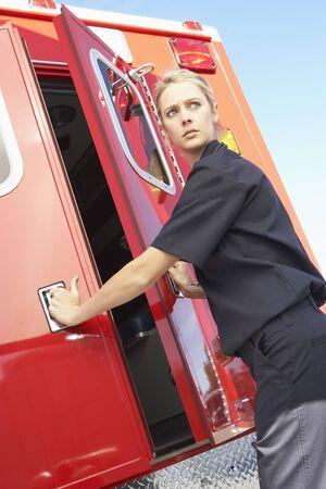 Paramedic closing ambulance doors photo
