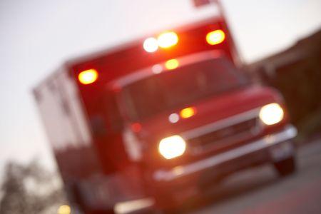 ambulance emergency: Defocused shot of ambulance on a city street Stock Photo