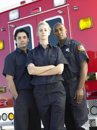 Portrait of paramedics standing in front of an ambulance photo