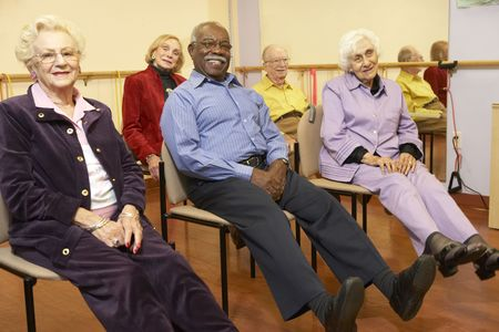 Senior adults in a stretching class Stock Photo - 4607319