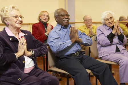 Senior adults in a stretching class Stock Photo - 4607524