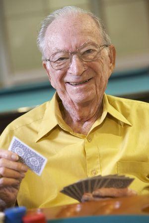 nineties: Senior man playing bridge Stock Photo