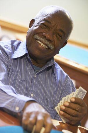 Senior man playing bridge photo