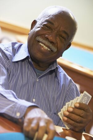 pensioner: Senior man playing bridge Stock Photo