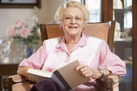 Senior woman reading book photo