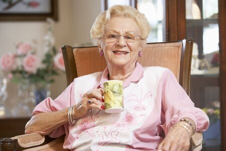 Senior woman drinking hot beverage Stock Photo - 4607620