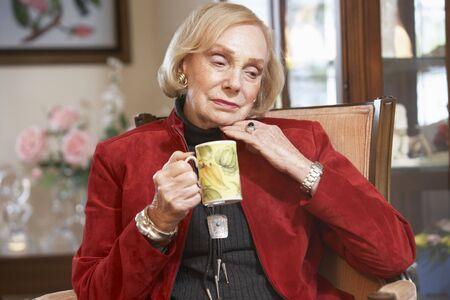 Senior woman drinking hot beverage Stock Photo - 4607309