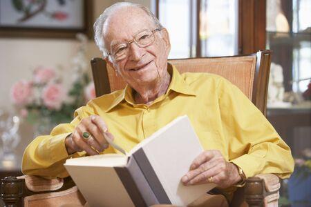 Senior man reading book photo